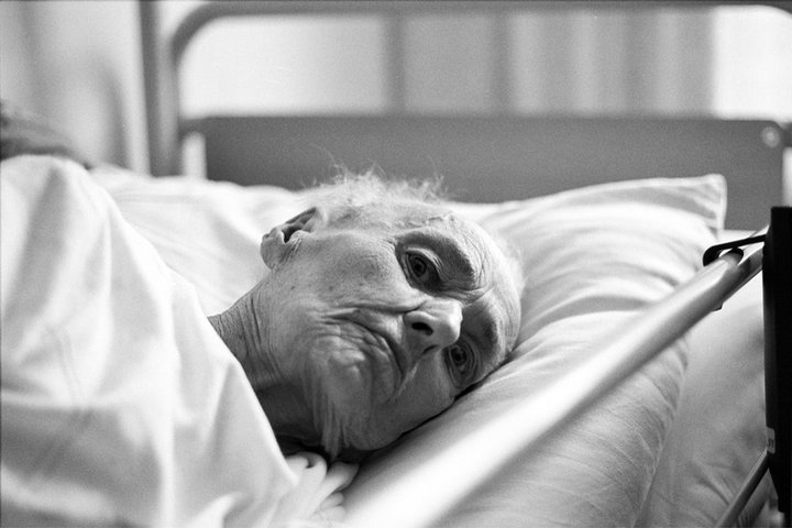 Old lady in hospital bed